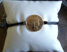 Bracelet cordon noir avec anneaux sur pièce 20 Francs Marianne or