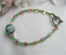 Handmade Glass Bead Bracelet ~ Green Lampwork Feature Bead With Pink Flower NEW