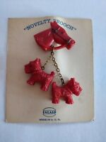 Art Deco celluloid westie dogs brooch unused on original backing card