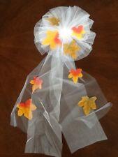 wedding pew bows. white with multicolor leaves.