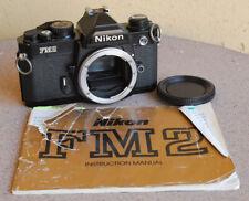 Nikon Black FM2 Manual Focus SLR film camera body with manual and cap - works