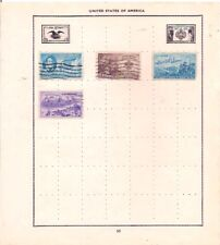 4 USA stamps on an album page.