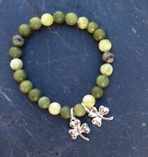 Connemara marble bracelet with lucky shamrock charms. Ireland Irish jewelry.