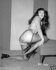Bettie Page wearing stockings kneeling with one leg on hassock 8 x 1 Photograph