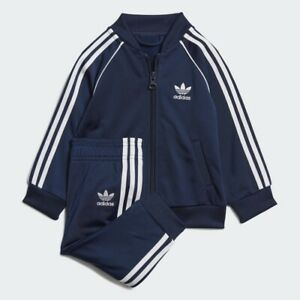 adidas Originals infant navy Superstar tracksuit. Ages 0-4 years.