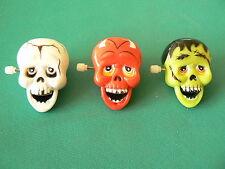 NUOVO Halloween tris teschietti spille con carica manuale per risata