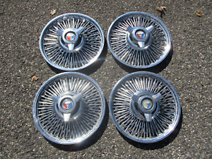 Genuine 1963 1964 Ford Galaxie 14 inch wire spoke spinner hubcaps wheel covers