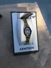 NWT Ladies Armitron watch, gold color, black face, new battery, orig $64.99