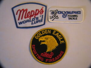 THREE VINTAGE PATCHES OLYMPIC FISHING TACKLE MEPPS #1 LURE GOLDEN EAGLE FIREARMS