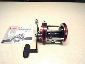 ABU GARCIA AMBASSADEUR FISHING REEL W/ PAPERWORK - RED 7000 - REEL WORKS GREAT