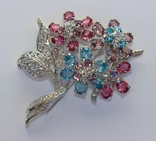 NOLAN MILLER Signed Rhodium Plated Blue Pink Lavender Clear Crystals Pin Brooch
