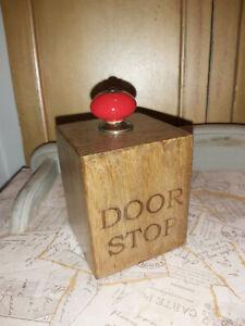 HANDMADE SOLID MANGO WOOD DOORSTOP WITH RED CERAMIC KNOB