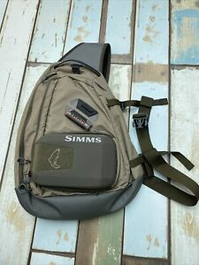 Simms fishing sling pack.