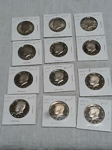 Lot of 12 uncirculated kennedy half dollars proof