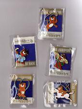 Lot de 5 pin's / Mascotte des jeux olympiques de Séoul 88 Hodori (neufs scellés)
