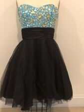 Formal dress with strapless jeweled top and black toulle bottom