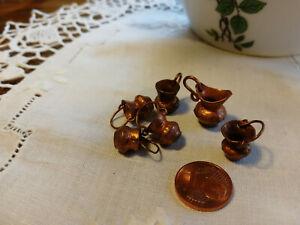 6 kleine Kupferkannen
