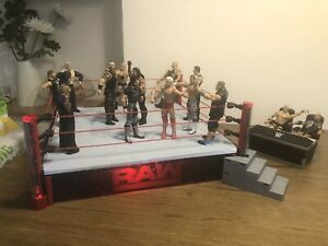 WWE RAW Wrestling Ring With 14 Figures And Props.
