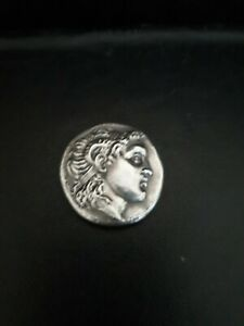 Antique coin, origin not known,possible silver, greek or Roman. GOOD CONDITION