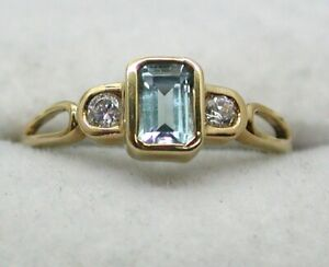 Lovely 9 carat Gold Blue Topaz And Cubic Zirconia Ring Size N