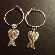 Angel wings hoop earrings silver in colour