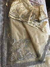 Fancy pre-owned Cream net saree with stonework and zari w/ ready made blouse