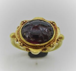 ANCIENT SASANIAN CARNELIAN INTAGLIO SET IN A HIGH CARAT GOLD RING 400-500AD