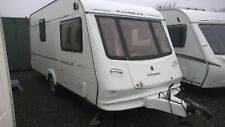 FOR HIRE - ACCOMMODATION IN A 2 BERTH TOURING CARAVAN - YOU TOW OR WE DELIVER