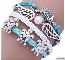 Nuevo bastante Turquesa Y Blanco Cable Caballito De Mar & Pulsera de tortugas marinas, vendedor de Reino Unido