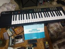 yamaha keyboard PSR-11 works great includes power cord. clean