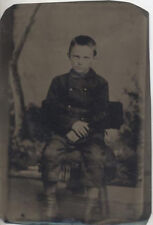 TINTYPE PORTRAIT OF STERN UNHAPPY YOUNG BOY W/ PAINTED BACKDROP