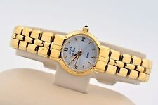 LADIES ANNE KLEIN GOLD TONE STAINLESS STEEL SILVER DIAL SWISS WATCH REVERSE BAND