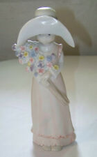 C1988 Enesco: KINKA - GIRL IN HAT, HOLDING FLOWERS 117757