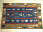 Flat Woven Tribal Kilim rug with dark blue background and gold border,.