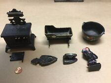 collection of caste iron toys, amish figure, stove