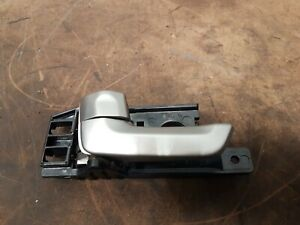KIA SPORTAGE KM 2008 MODEL  LEFT HAND REAR INTERIOR DOOR HANDLE