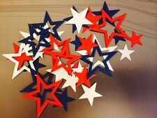 SUPER ASSORTMENT OF 60 SOLID AND OPENWORK RED, WHITE, AND BLUE PATRIOTIC STARS.