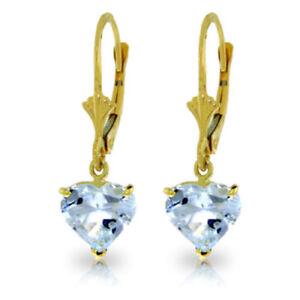 Genuine Aquamarine Gems Hearts Leverback Earrings In 14K Yellow Gold