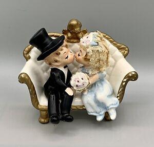 Wilton Bride & Groom Cake Topper Kissing On Cherub Couch Bride Has Blonde Hair
