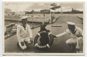 "GERMANY · 1930s: unused real photo PPC with sailors on ""Kreuzer Emden"" w/ mascot"