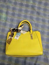Purse, Call It Spring. Bright yellow/black trim. scales/scarf/metal accents