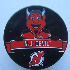 "Official NHL Licensed puck of the New Jersey Devils Mascot ""N.J. Devil"""