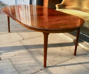 1970s vintage Rosewood round extendable dining table by Olaf TH Larsen