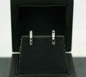 9ct White Gold 0.09ct Diamond Huggie Earrings