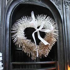 Ghirlande, corone e fiori natalizi bianco Natale