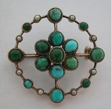 A GORGEOUS GOLD BROOCH PIN SET WITH 15 TURQUOISE STONES AND 8 SEED PEARLS