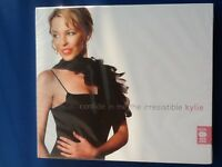 KYLIE. MINOGUE.       CONFIDE. IN. ME.   THE. IRRESISTIBLE.          TWO. DISCS.