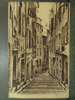 cpa 06 nice une rue de la vieille ville
