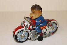 Tin Haji monkey animal cop motorcycle made in Japan in the 1960's