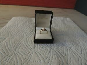 8CT 333 GOLD RING WITH REAL PEARL.2.13 GRAMS.SIZE N. HALLMARKED.